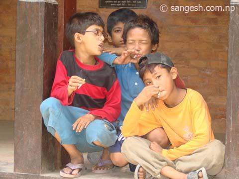 Boys Giving Pose While They Smoking