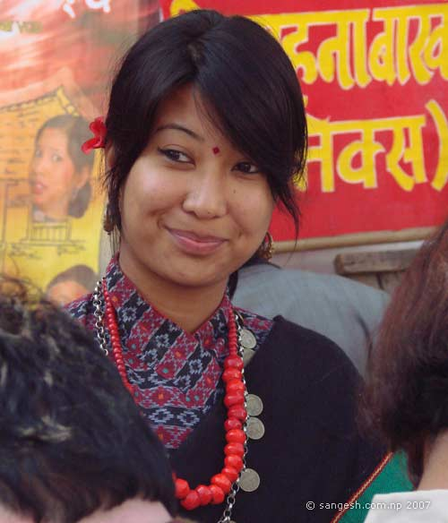 Newari girl with sweet smile Inviting the participants