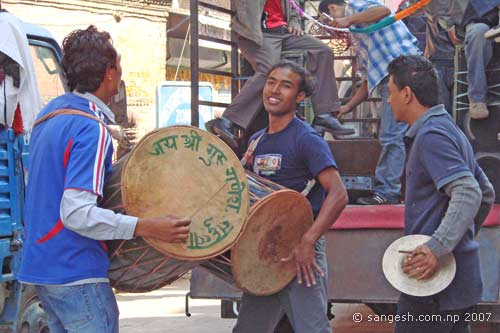 Guys dancing and playing the drums
