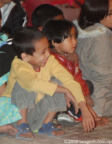 Young kid enjoying the Kartik Nach Drama